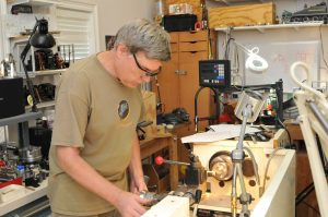 Author Ed Hume working at the lathe in his home workshop.